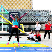 BBC's Beccy Wood is taking part in a Commonwealth Challenge for Sport Relief. She is cycling to several Commonwealth Games venues. One of her stops will be at the Birmingham 2022 Countdown Clock in Centenary Square. Pictured Beccy Wood from BBC, Ian Reid, CEO of Birmingham 2022, Preet Gill, MP, Gymnasts from Revolution Gymnastics Club and Gymnasts from University of Birmingham Gymnastics Club. Picture by Shaun Fellows / Shine Pix Ltd