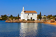 Greek Orthodox church of  Ipapandi,  Gouvia Bay, Corfu Greek Ionian Island .<br /> <br /> If you prefer to buy from our ALAMY PHOTO LIBRARY  Collection visit : https://www.alamy.com/portfolio/paul-williams-funkystock/corfugreece.html <br /> <br /> Visit our GREECE PHOTO COLLECTIONS for more photos to download or buy as wall art prints https://funkystock.photoshelter.com/gallery-collection/Pictures-Images-of-Greece-Photos-of-Greek-Historic-Landmark-Sites/C0000w6e8OkknEb8