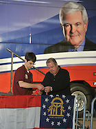February 17, 2012 PEACHTREE CITY:  Scott Reagan and John Douglas hang the Georgia flag before the start of the Newt Gingrich  rally in Hanger B4  at Peachtree City-Falcon Field in Peachtree City on  Friday, February 17, 2012. ©2012 Johnny Crawford