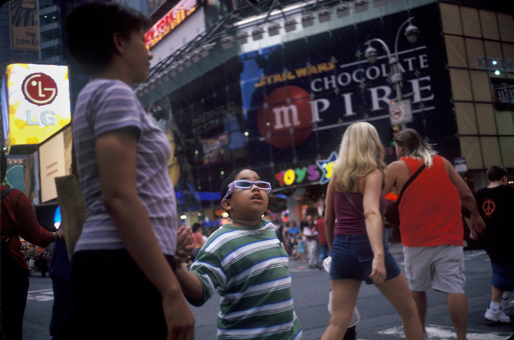 Child in Times Square, New York, New York.