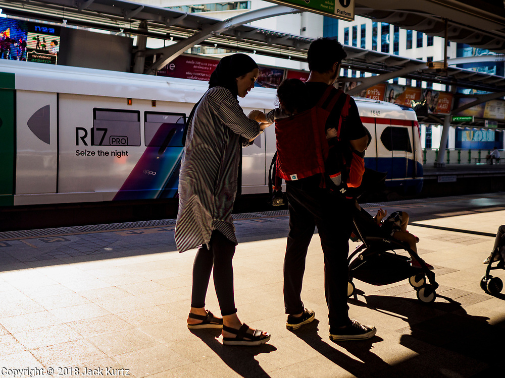 17 DECEMBER 2018 - BANGKOK, THAILAND: Tourists wait for a BTS Skytrain to come into the Nana Station in the Sukhumvit Road tourist district in central Bangkok. According to Credit Suisse Global Wealth Databook 2018, which surveyed 40 countries, Thailand has the highest rate of income inequality in the world. In 2016, Thailand was third, behind Russia and India. In 2016, the 1% richest Thais (about 500,000 people) owned 58.0% of the Thailand's wealth. In 2018, they controlled 66.9%. In Russia, those numbers went from 78% in 2016, down to 57.1% in 2018. The Thai government disagreed with the report and said the report didn't take government anti-poverty programs into account and that Thailand was held to an unfair standard because most of the other countries in the report are developed countries in the Organisation for Economic Co-operation and Development.    PHOTO BY JACK KURTZ