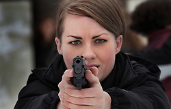 Meghan Mulherin, a member of Hillary Clinton's security detail, takes part in training drills at the Marine Corps Base Quantico, Va. on Dec. 17, 2011.