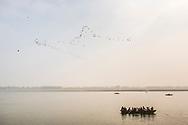 Pilgrims on a boat on the River Ganges, Varanasi, Uttar Pradesh, India