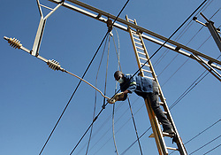 South Africa - Pretoria - 3 July 2020 - Workers repair the overhead cables at the Loftus station, trains on the Pienaarsport-Pretoria line were not running due to cable theft at the station.<br /> Picture: Jacques Naude/African News Agency(ANA)