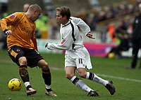 Photo: Rich Eaton.<br /> <br /> Wolverhampton Wanderers v Leeds United. Coca Cola Championship. 24/02/2007. Eddie Lewis right of Leeds turns inside Wolves Michael Kightly