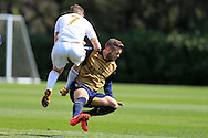 Jack Wilshere of Arsenal in action for the Arsenal u21 team as he takes a hit from Dan James of Swansea. . Barclays U21Premier league match, Swansea city U21's v Arsenal U21's at the Landore training ground in Swansea, South Wales on Thursday 14th April 2016.<br /> pic by Andrew Orchard, Andrew Orchard sports photography.