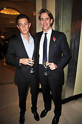 Left to right, JAMES ROTHSCHILD and BEN ELLIOT at a party to celebrate the publiction of 'No Invitation Required' by Annabel Goldsmith, held at Claridge's, Brook Street, London on 11th November 2009.