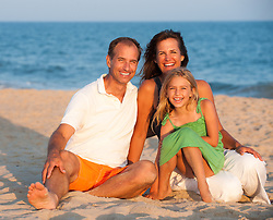 beautiful family outdoors on the beach in The Hamptons
