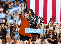 October 27, 2016 - Winston-Salem, North Carolina, U.S. - Democratic presidential candidate HILLARY CLINTON and first lady MICHELLE OBAMA acknowledge the reception during an early vote rally at Joel Coliseum. (Credit Image: © Ethan Hyman/TNS via ZUMA Wire)