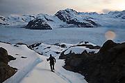 Dr. Tad Pfeffer, a glaciologist with the University of Colorado, hikes down the Great Nunatak towards camp at the Columbia Glacier, near Valdez, Alaska.