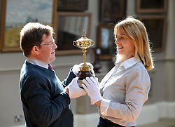 Hamish Wilson and Amanda Doves from Bonham's with the replica Ryder Cup presented to Sergio Garcia in 2001,  which is expected to fetch up to £8000 GBP in Bonham's sporting goods sale.<br /> <br /> © Dave Johnston/ EEm