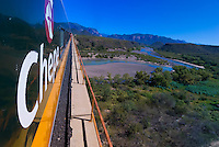The Chihuahua al Pacifico Railroad (Chepe) train crossing the Agua Caliente Bridge over the Rio Fuerte (river), near the Copper Canyon, Mexico