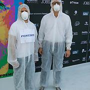 NLD/Amsterdam/20130903 - Filmpremiere Jobs , Mannen in witte pakken met Foxconn logo