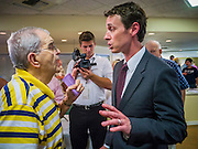 "09 AUGUST 2012 - SCOTTSDALE, AZ: Congressman BEN QUAYLE (R-AZ) talks to a constiuent who complained to Quayle about what he called the Republicans ""war"" on women's health care after a candidate forum at an adult assisted living facility in Scottsdale, AZ, Thursday. Quayle told the man that President Obama didn't respect corporations' religious rights when he mandated contraceptive health care. Republican Congressmen Ben Quayle and David Schweikert are facing each other in Arizona's Aug. 28 Republican primary. They are vying for the right to represent Arizona's 6th Congressional District. Both men are incumbent freshmen Congressmen. They were thrown into the same district during the redistricting process after the 2010 census. Both men are conservatives courting the Tea Party vote.    PHOTO BY JACK KURTZ"