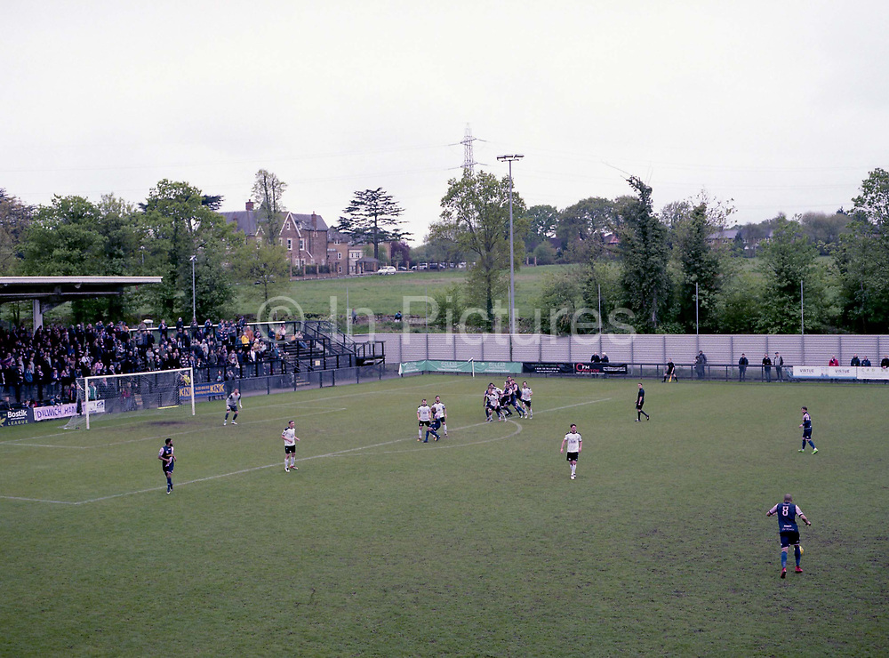 Free kick taken by Ashley Carew. Dulwich Hamlet V Margate during the last league game of the season at DHFC temporary ground at Imperial Fields on 28th April 2018 in Mitcham, South London in the United Kingdom. Dulwich Hamlet was founded in 1893 and both teams play in the Isthmian League Premier Division, a regional mens football league covering London, East and South East England.