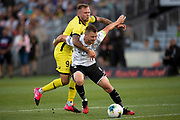 Wellington Phoenix David Ball battles for the ball with Melbourne's Scott Jamieson, during the Hyundai A-League football match, between Wellington Phoenix and Melbourne City FC, held at Eden Park, Auckland, New Zealand.  15  February  2020    Photo: Brett Phibbs / www.photosport.nz