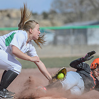Farmington Scorpion Abby Danielle (99) tags out Gallup Bengal Danielle Silversmith (5) at third base as she slide in during the game held at Gallup High School Friday.