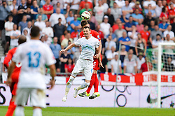 Milivoje Novakovic of Slovenia and Gary Cahill of England during the EURO 2016 Qualifier Group E match between Slovenia and England at SRC Stozice on June 14, 2015 in Ljubljana, Slovenia. Photo by Mario Horvat / Sportida