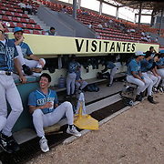 MINATITLAN, MEXICO:  Saltillo Sarapero players enjoy a laugh between innings of a game in Minatitlan, Mexico.