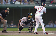 July 26, 2001 - Cleveland, Ohio - Cleveland Indians second baseman Roberto Alomar bats in a MLB game against the Chicago White Sox at Jacobs Field in Cleveland Ohio. Catching is his brother White Sox catcher Sandy Alomar, Jr. Roberto Alomar was elected to the National Baseball Hall of Fame on Jan. 6, 2011.