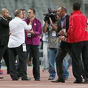 Istanbul BBSpor's coach Abdullah AVCI (2ndR) and Galatasaray's coach Fatih TERIM (2ndL) during their Turkish soccer superleague match Istanbul BBSpor between Galatasaray at the Ataturk Olympic stadium in Istanbul Turkey on Sunday 11 September 2011. Photo by TURKPIX