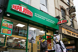 © Licensed to London News Pictures. 09/10/2020. London, UK. Members of public wearing face coverings walk past a branch of Papa Johns in north London. <br /> Papa Johns UK is investigating claims that a franchisee made fraudulent claims, totalling over £250,000, as part of the Government's Eat Out to Help Out Scheme. Photo credit: Dinendra Haria/LNP