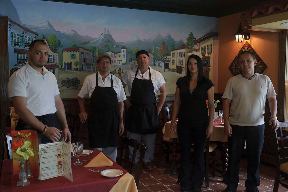 Fredy Umaña from El Salvador, Isaias Soza from El Salvador, Vicente Pastrana from Colombia, Liliana Vargas from Colombia and Gildardo Anaya from Colombia pose for a photograph at Casa Vieja, a Latin American Cuisine restaurant located in Brentwood. (July. 19, 2012)
