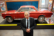 """Consumer advocate Ralph Nader poses in front of a Chevrolet Corvair in The American Museum of Tort Law, Friday, Sept. 25, 2015, in Winsted, Conn. The museum, which opens Saturday, has been developed by the consumer advocate and two-time presidential candidate as a kind of ode to the jury system. Nader featured the Corvair in his 1965 book on the auto industry's safety record, """"Unsafe at Any Speed"""". (AP Photo/Jessica Hill)"""