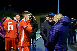 BANGOR, WALES - Tuesday, November 20, 2018: Wales' Joseph Adams speaks with family members after a 2-0 victory over San Marino in the UEFA Under-19 Championship 2019 Qualifying Group 4 match between Wales and San Marino at the Nantporth Stadium. (Pic by Paul Greenwood/Propaganda)