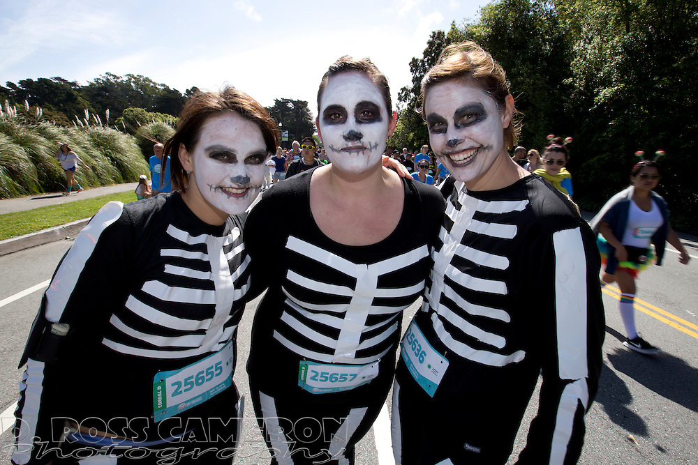 The anatomy might not be exactly right, but San Franciscans Anna Singer, from left, Jacqueline Pirie and Kacee Williams make passable skeletons during the 103rd running of the Bay to Breakers 12K race, Sunday, May 18, 2014 in San Francisco. (Photo by D. Ross Cameron)