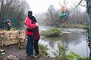 Activists embrace in front of Dan Hooper, better known as roads protester Swampy during the 1990s, in a tripod positioned in the river Colne in order to try to delay bridge building works in connection with the HS2 high-speed rail link on 7 December 2020 in Denham, United Kingdom. Anti-HS2 activists continue to resist the controversial £106bn rail project from a series of protest camps based along its initial route between London and Birmingham.