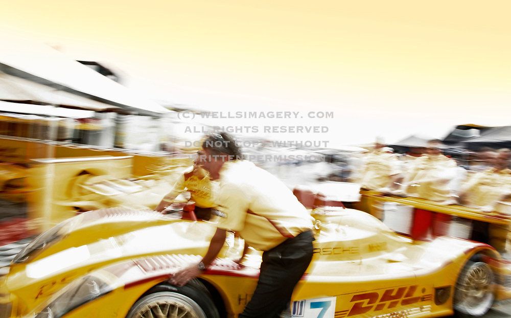 Image of a yellow Porsche Spyder RS race car with DHL livery at Rennsport V, Mazda Raceway Laguna Seca, Monterey, California, America west coast by Randy Wells