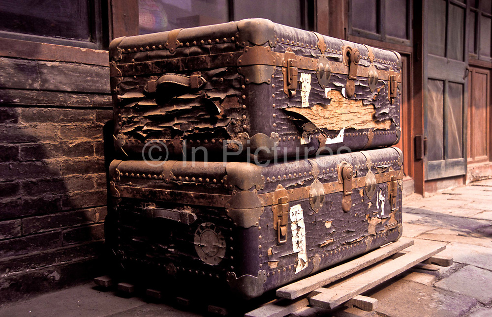 Inside a traditional Beijing courtyard house, Mr Chen Yun Jiang's opera singer father's ( Chen Yan Qiu), original travelling trunks which would contain his Opera costumes when he performed.