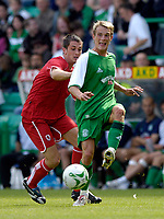 Photo: Jed Wee/Sportsbeat Images.<br /> Hibernian v Middlesbrough. Pre Season Friendly. 28/07/2007.<br /> <br /> Hibs' Brian Kerr (R) keeps Middlesbrough's Andrew Taylor away from the ball.
