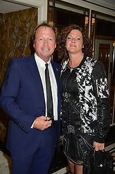 Musician MARK KING and his wife RIA at the David Shepherd Wildlife Foundation Wildlife Ball at The Dorchester, Park Lane, London on 9th October 2015.