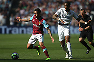 Manuel Lanzini of West Ham United (L) in action with Leroy Fer of Swansea City (R). Premier league match, West Ham Utd v Swansea city at the London Stadium, Queen Elizabeth Olympic Park in London on Saturday 8th April 2017.<br /> pic by Steffan Bowen, Andrew Orchard sports photography.