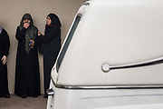 Jamila Alrazouk is comforted by a friend as she grieves the loss of husband Riad Alsaloum, moments before a hearse drives his casket away from the family's mosque following pre-burial prayers in Tampa, Florida, U.S.