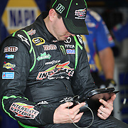 NASCAR Sprint Cup driver Kyle Busch (18) is seen in the garage area during the NASCAR Coke Zero 400 Sprint practice session at the Daytona International Speedway on Thursday, July 4, 2013 in Daytona Beach, Florida.  (AP Photo/Alex Menendez)