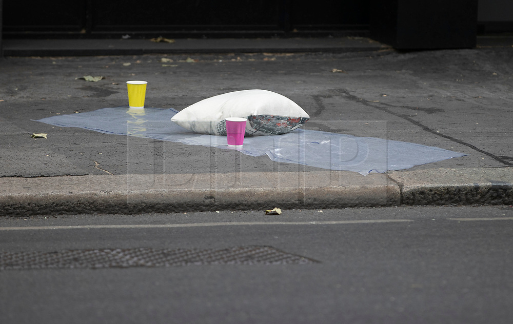 © Licensed to London News Pictures. 03/06/2020. London, UK. A police evidence bag is seen under a cushion near an abandoned Kia Niro mini cab on Sloane Square. It is being reported that two people have been injured in the incident where it is thought a car mounted the pavement. Photo credit: Peter Macdiarmid/LNP