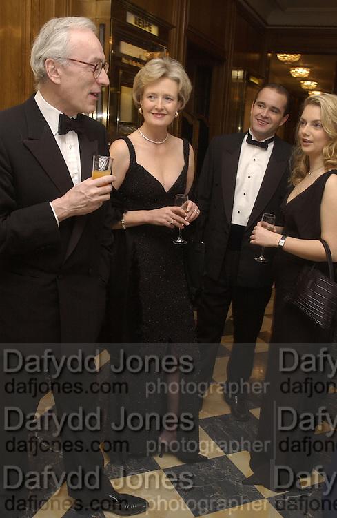Lord and Lady Chadlington, Olly Spry and  Sybilla Rufus-Isaacs. Crillon Debutantes Ball 2002. Paris. 7 December 2002. © Copyright Photograph by Dafydd Jones 66 Stockwell Park Rd. London SW9 0DA Tel 020 7733 0108 www.dafjones.com