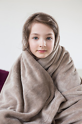 Portrait of girl covered with blanket, close up