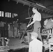 Male glassblower in glass works, Finland 1955