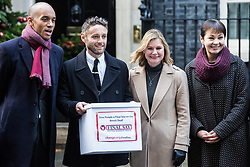 London, UK. 3rd December, 2018. People's Vote spokesman Chuka Umunna MP, editor of the Independent Christian Broughton, Justine Greening MP and Caroline Lucas MP deliver a Final Say petition signed by over a million people to 10 Downing Street to be presented to Prime Minister Theresa May following her return from the G20 summit in Buenos Aires.