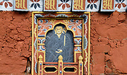 Carved slate    panel showing a Buddha decorated in traditional Bhutanese style on one of the 108 Chortens at Dochu La, a high pass (3140m) on the road between Thimpu and Wangdue. The chortens were built in 2005 in atonement for the lives lost in the joint action with India  in 2003 to drive Assamese militants from Bhutan. They act as a reminder that the problem still exits and that Bhutanese dissidents are involved. Dochu La, Bhutan. 13 November 2007.