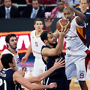 Galatasaray's Preston SHUMPERT (R) and Anadolu Efes's Ermal KURTOGLU (C) during their BEKO Basketball League derby match Galatasaray between Anadolu Efes at the Abdi Ipekci Arena in Istanbul at Turkey on Sunday, November 13 2011. Photo by TURKPIX