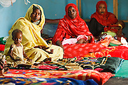 Women sit with their malnourished children at the UNICEF-sponsored Mao therapeutic feeding center in the town of Mao, Kanem region, Chad on Monday February 13, 2012.