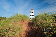 Lighthouse and sand dunes. West Cape