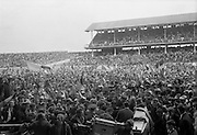 04/09/1966<br /> 09/04/1966<br /> 4 September 1966<br /> All-Ireland Senior Hurling Final: Kilkenny v Cork at Croke Park, Dublin.<br /> After the presentation of the cup, thousands of Cork supporters cheer as they swarm onto the pitch to greet their victorious team.