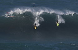 December 13, 2017 - Waimea Bay, HI, USA - WAIMEA BAY, HI - DECEMBER 13, 2017 - Professional surfer John John Florence of Hawaii, right (green board) drops in on a large wave at Waimea Bay. The big wave surfing spot only breaks in the winter when storms send large north swells toward the North Shore of Oahu. (Credit Image: © Erich Schlegel via ZUMA Wire)