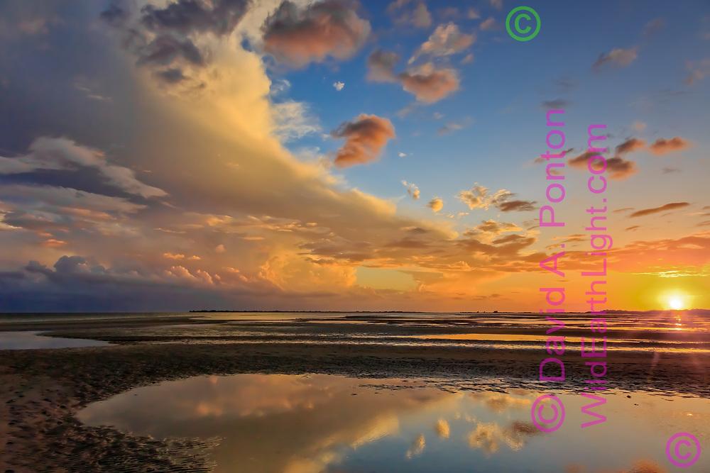 Clearing storm at sunset over tide pools on San Carlos Bay, Florida, America, © David A. Ponton